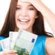 Stock Photo: Lovely teenage girl with money