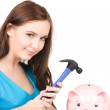 Teenage girl with piggy bank and hammer — Stock Photo #8320743