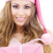 Happy santa helper with gift box — Stock Photo