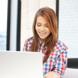 Happy woman with laptop computer — Stock Photo #8701487