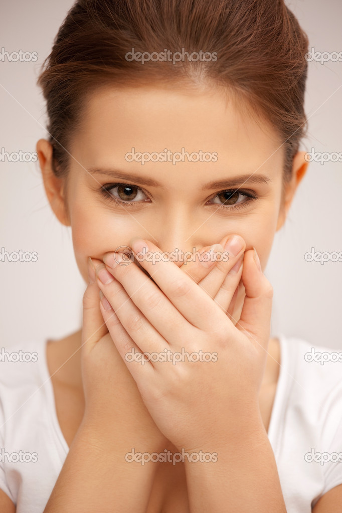 Bright closeup picture of woman with hand over mouth — Stock Photo #8730714