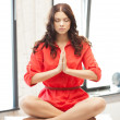 Calm attractive woman in lotus pose — Stock Photo #8743603