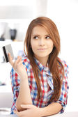 Pensive woman with credit card — Stock Photo