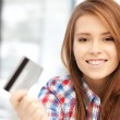 Happy woman with credit card — Stock Photo #9067299