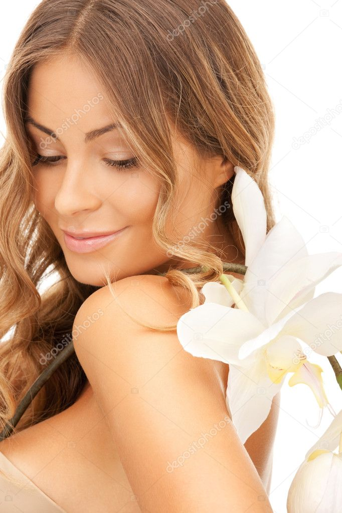Picture of beautiful woman with orchid flower — Stock Photo #9066535