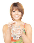 Woman with pill and glass of water — Stock Photo
