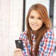 Happy woman with credit card — Stock Photo #9134119