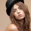 Beautiful topless woman in bowler hat — Stock Photo #9168455