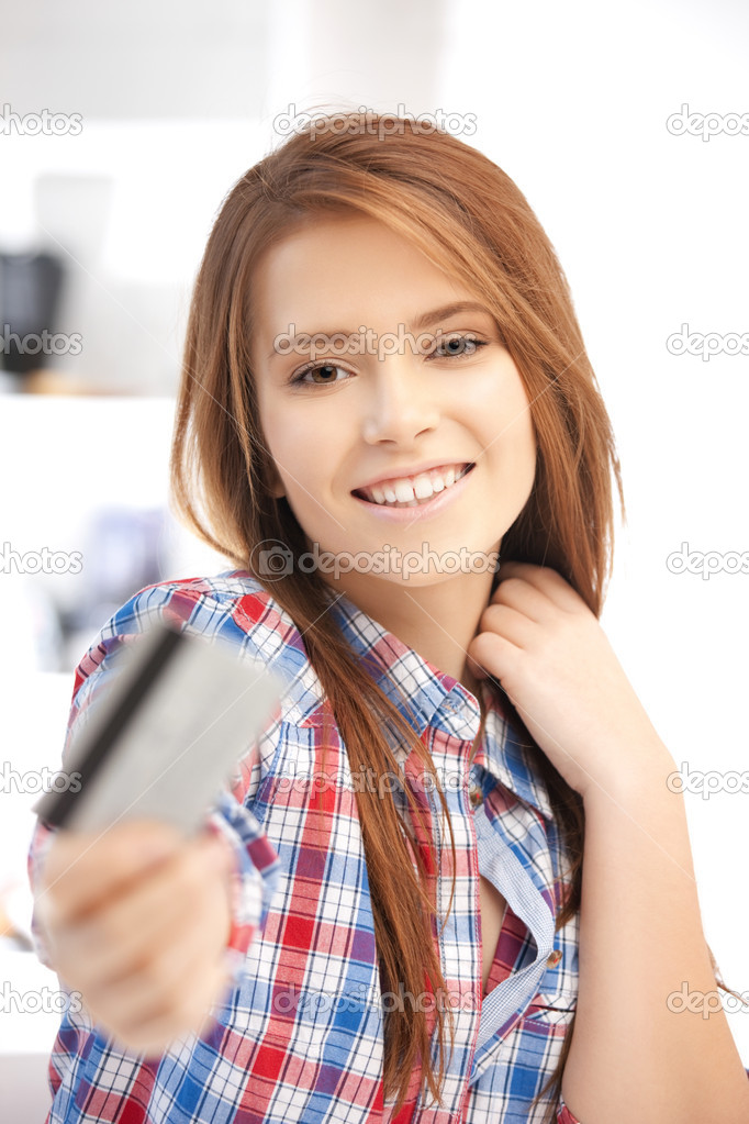 Bright picture of happy woman with credit card  Stock Photo #9168588