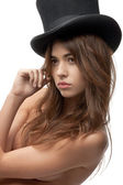 Beautiful topless woman in top hat — Stock Photo