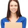 Attractive businesswoman with cardboard box — Stock Photo #9274926
