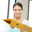 Woman with folder — Stock Photo #9423772