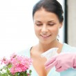 Lovely housewife with flower — Stock Photo #9423787