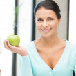 Lovely housewife with green apple — Stock Photo #9423803