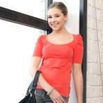Happy and smiling teenage girl — Stock Photo #9481386