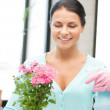 Lovely housewife with flower — Stock Photo #9482166