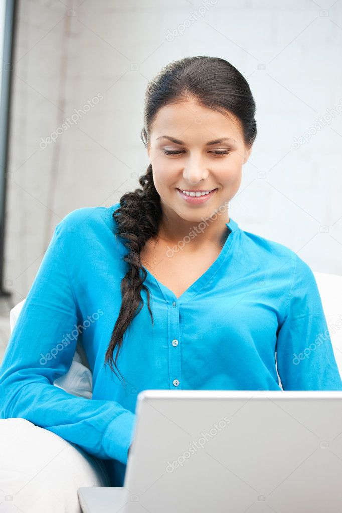 Picture of happy woman with laptop computer.  Stock Photo #9482292