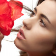 Lovely woman with red flowers — Stock Photo #9513373