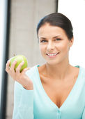 Lovely housewife with green apple — Stock Photo