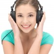 Happy teenage girl in big headphones — Stock Photo #9569127
