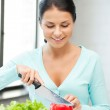 Beautiful woman in the kitchen — Stock Photo #9569447