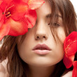 Stock Photo: Lovely womwith red flowers