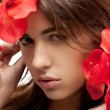 Lovely woman with red flowers — Stock Photo #9627510