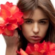 Lovely woman with red flowers — Stock Photo #9627541