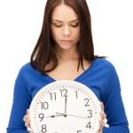 Woman holding big clock — Stock Photo #9715187