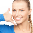 Stock Photo: Woman making a call me gesture