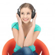 Happy teenage girl in big headphones — Stock Photo #9715317