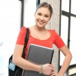 Happy and smiling teenage girl with laptop — Stock Photo #9715324