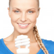 Woman holding energy saving bulb — Stockfoto