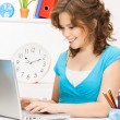 Happy woman with laptop computer — Stockfoto