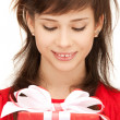 Happy teenage girl with gift box - Stock Photo