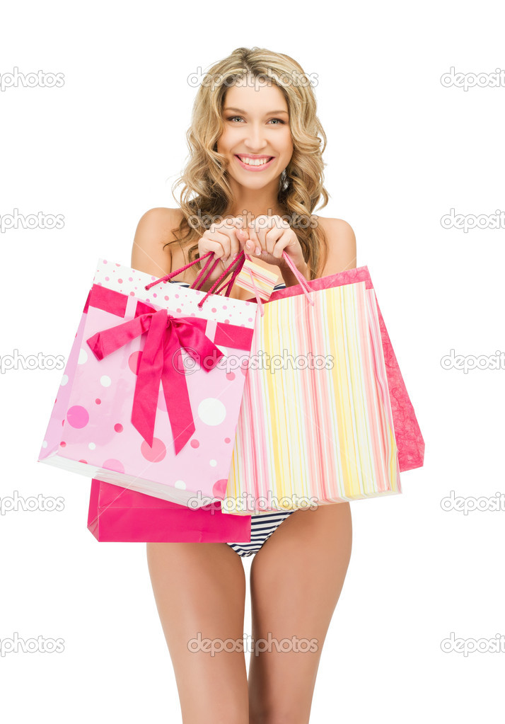 Picture of seductive woman in bikini with shopping bags — Zdjęcie stockowe #9800582