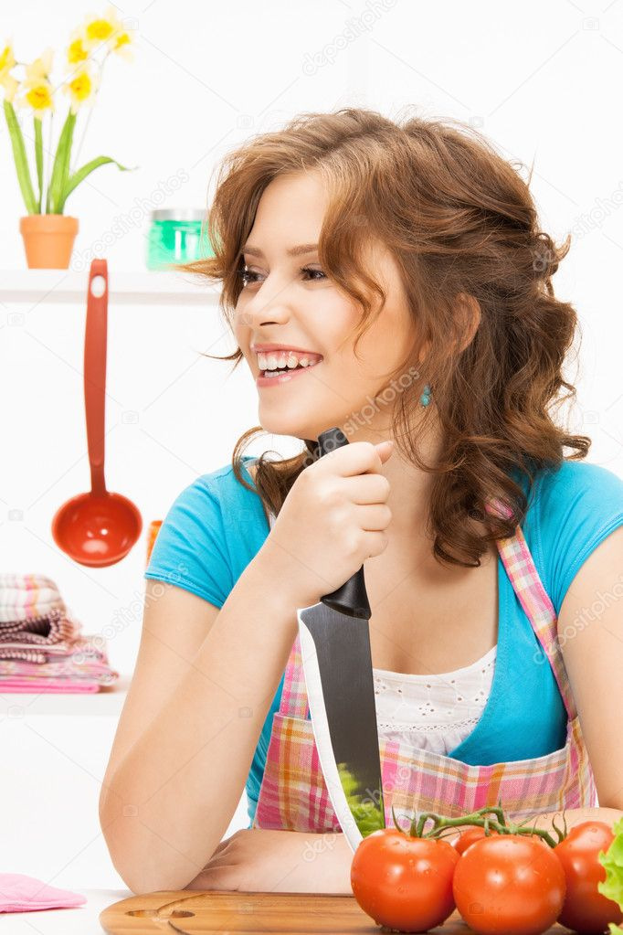 Picture of beautiful woman in the kitchen — Stock Photo #9830446