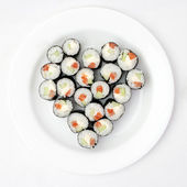 Sushi on a plate in the shape of heart — Stock Photo