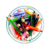 Colored pencils in a clear glass jar. top view — Stock Photo