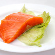 Fresh salmon steak on white plate — Stock Photo