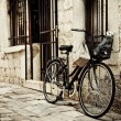 Bicycle in cobble street — Stock Photo