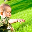 Baby on grass — Stock Photo