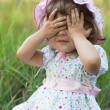 Little girl playing peek-a-boo — Stock Photo