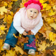 Girl in yellow leaves — Stockfoto