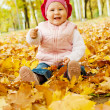 Laughing autumn kid — Stock Photo