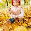 Laughing autumn kid — Stok fotoğraf