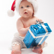 Baby sits with blue present box — Stock Photo