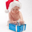Baby playing with present box — Stock Photo