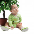 Royalty-Free Stock Photo: Baby sitting under green tree