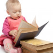 Baby girl reading book - Stok fotoğraf